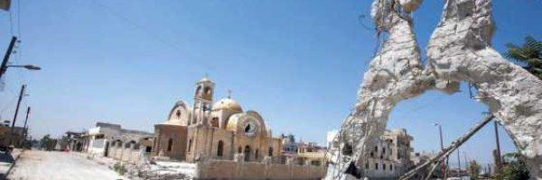 Imagen de una de las esquinas de Qusayr, captada en agosto de este año. Gran parte de la ciudad está en escombros. / AFP